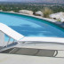Tropitone South Beach Four Position Stacking Armless Chaise (Package of 3) by the pool