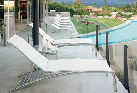 Tropitone South Beach Four Position Stacking Armless Chaise (Package of 3) on balcony